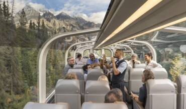 rocky-mountaineer-host-tells-story-to-guests
